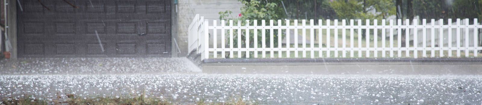 Picture of a heavy hail storm in residential neighborhood.